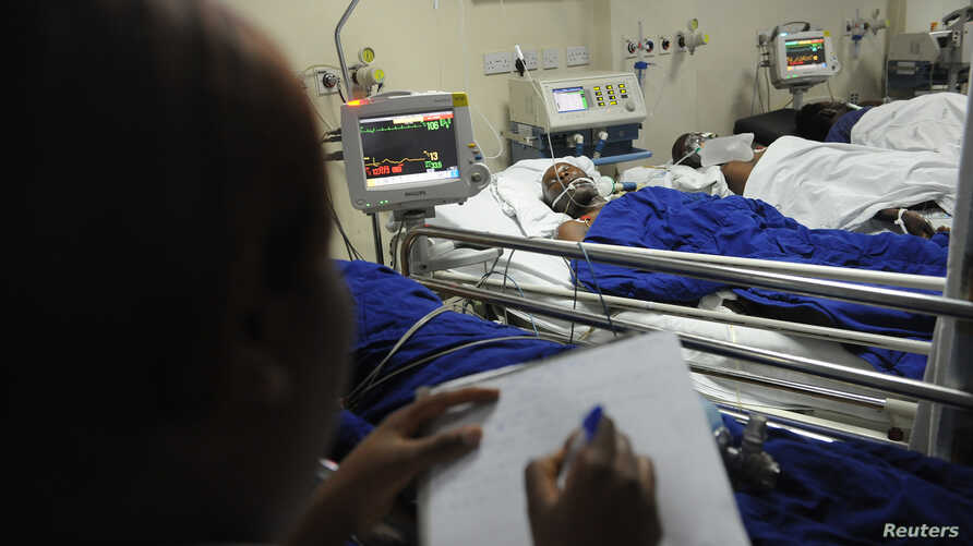 A nurse takes notes at the Kenyatta National hospital after patients drank an illegal alcohol that killed seven people and caused 10 others to go  blind, in Nairobi, Kenya,  April 9, 2010.