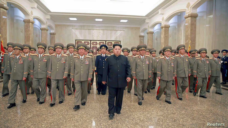 North Korean leader Kim Jong Un visits the Kumsusan Palace of the Sun to mark the 21st anniversary of the death of founder Kim Il Sung in this undated picture released by North Korea's Korean Central News Agency on July 8, 2015.