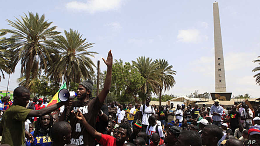 Senegalese rapper Thiat, a leader of the 'Y en a marre' (Enough is Enough) opposition group, addresses protesters during an opposition rally demanding that Senegalese leader Abdoulaye Wade renounce his bid for a third presidential term in Dakar, Sene