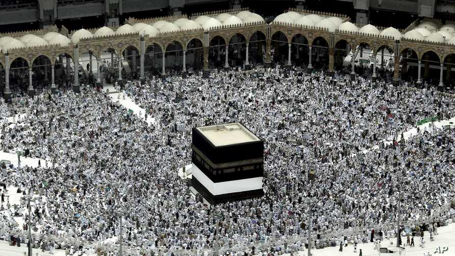 Muslim pilgrims prepare themselves for Friday prayers in front of the Kaaba, Islam's holiest shrine, at the Grand Mosque in the Muslim holy city of Mecca, Saudi Arabia, Sept. 9, 2016.