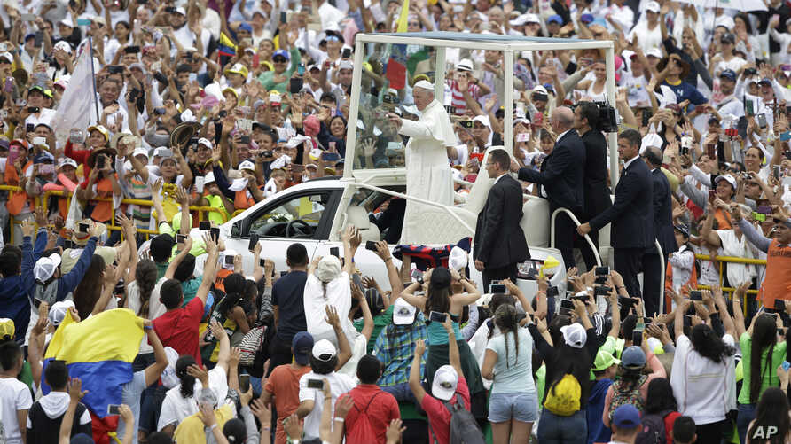 People greet Pope Francis as he arrives to celebrate Mass in Villavicencio, Colombia, Sept. 8, 2017.