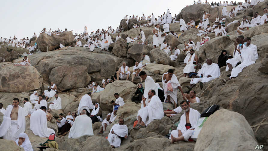 Muslim pilgrims gather to pray at Jabal Al Rahma holy mountain, or the mountain of forgiveness, during the annual pilgrimage, known as the hajj, near Mecca, Saudi Arabia, Oct. 3, 2014.