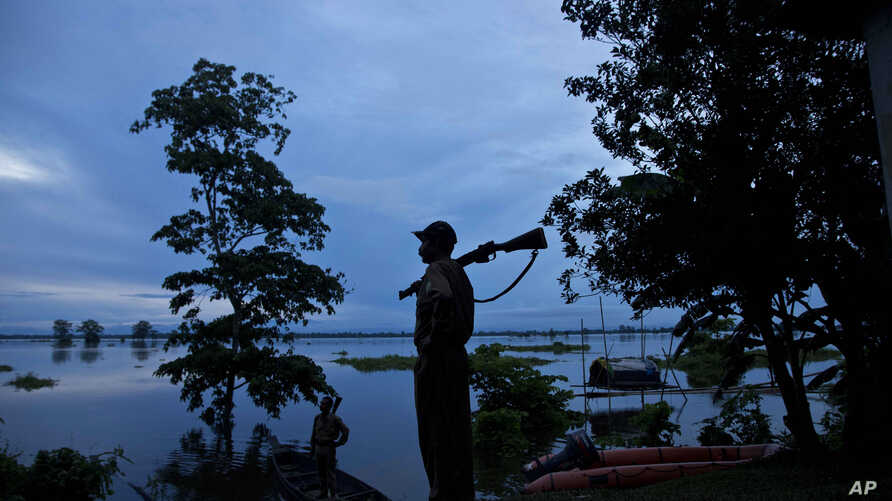 A forest guard keeps vigil at the flooded Kaziranga National Park, east of Gauhati, northeastern Assam state, India, July 26, 2016.