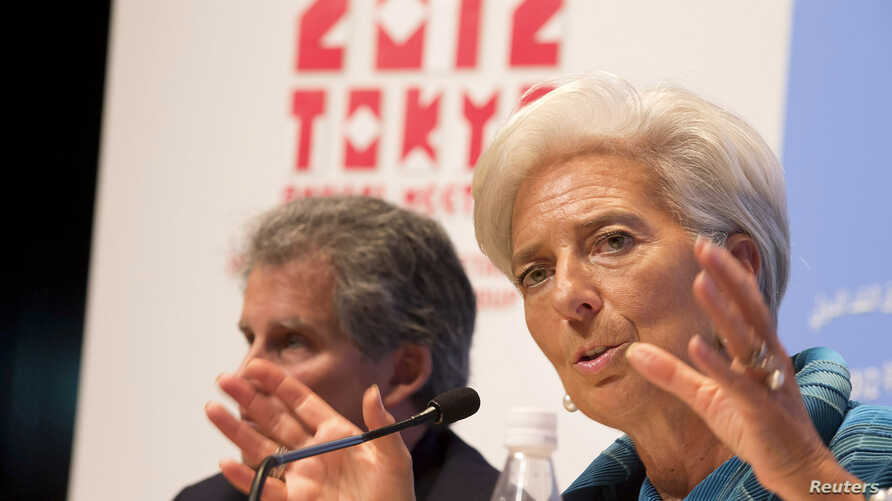 International Monetary Fund (IMF) Managing Director Christine Lagarde (R) and IMF First Deputy Managing Director David Lipton hold a news conference at the annual meetings of the International Monetary Fund and the World Bank Group in Tokyo October 1
