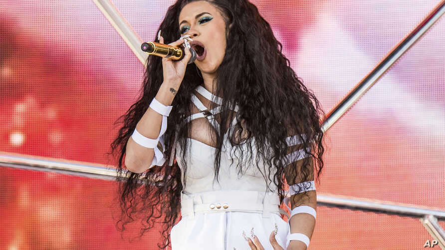 FILE- Cardi B performs at the Coachella Music & Arts Festival at the Empire Polo Club in Indio, Calif., April 22, 2018.