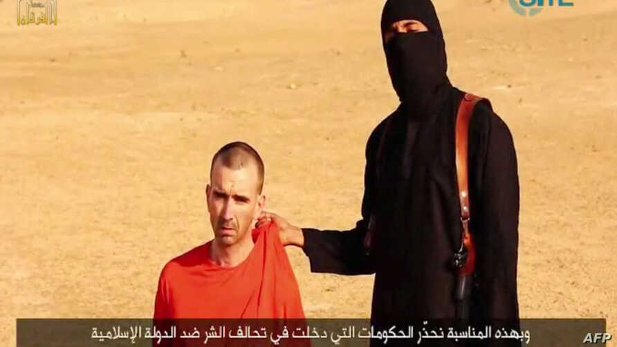 An image taken from a video released by the Islamic State (IS) and identified by private terrorism monitor SITE Intelligence Group on Sep. 2, 2014 purportedly shows footage of a masked militant in a desert landscape threatening to kill British David