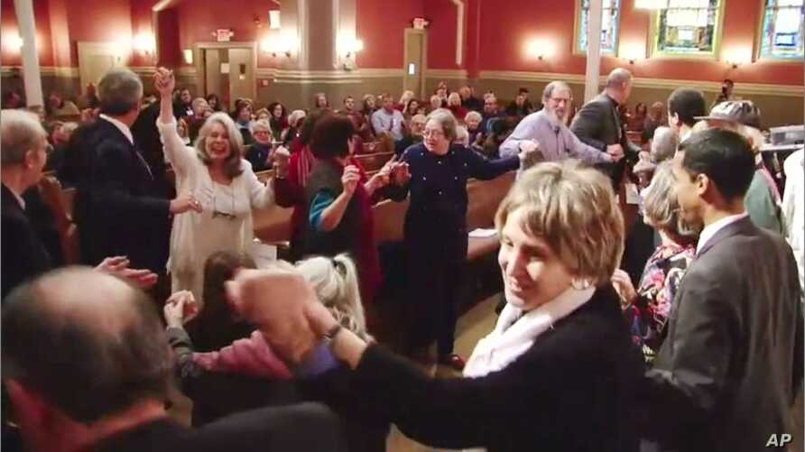 """Members of """"Yes We Can: Middle East Peace"""" dance together at a historic synagogue in downtown Washington DC"""