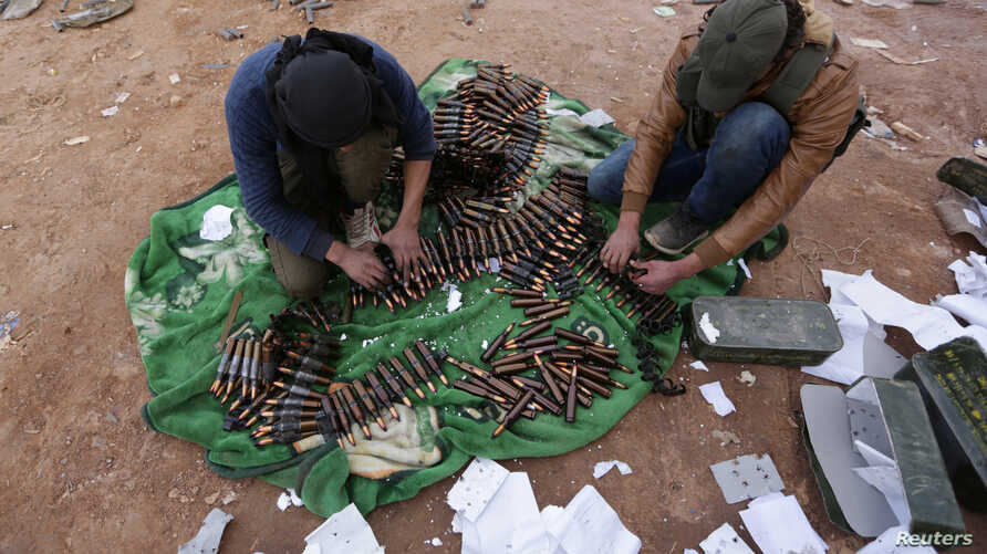 Rebel fighters arrange shells on the outskirts of the northern Syrian town of al-Bab, Syria, Jan. 26, 2017.