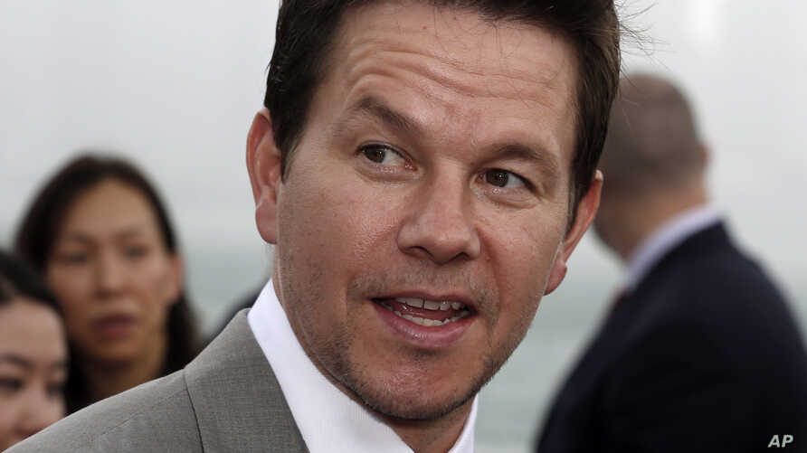 """FILE - In this June 19, 2014, file photo, actor Mark Wahlberg arrives for the world premiere of the movie """"Transformers 4: Age of Extinction"""" in Hong Kong."""