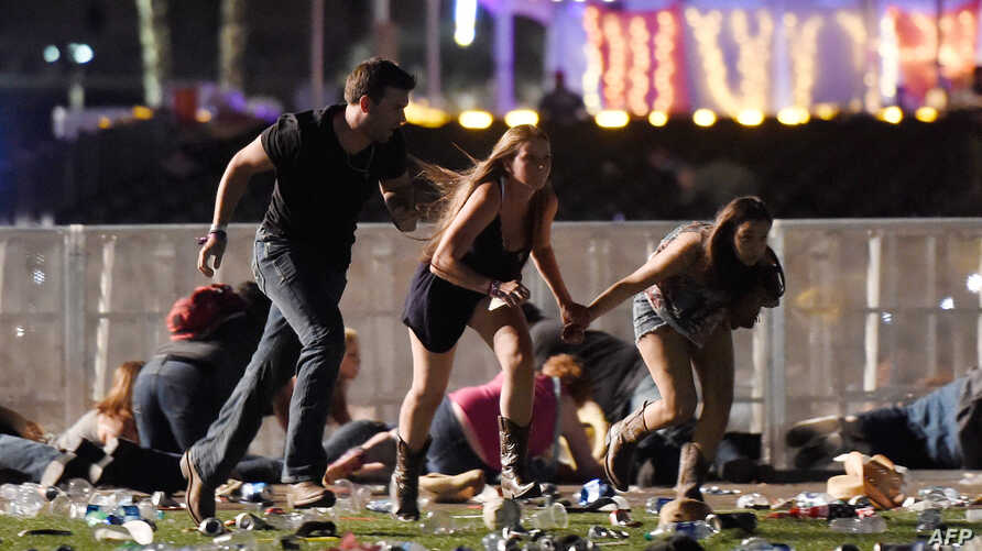 People run from the Route 91 Harvest country music festival after apparent gun fire was hear on Oct. 1, 2017 in Las Vegas, Nevada.