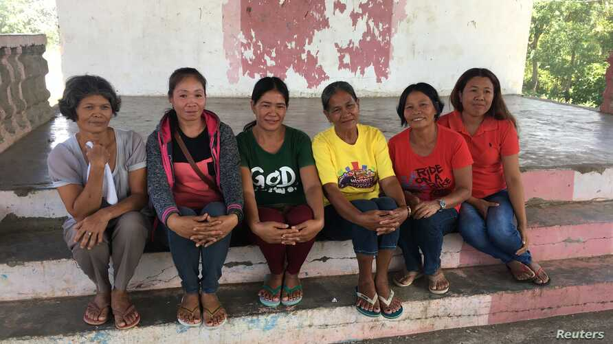 The women in Pamantingan village are among the millions of Filipino women who moved to cities and other countries to find jobs, leaving their families behind, March 20, 2018.