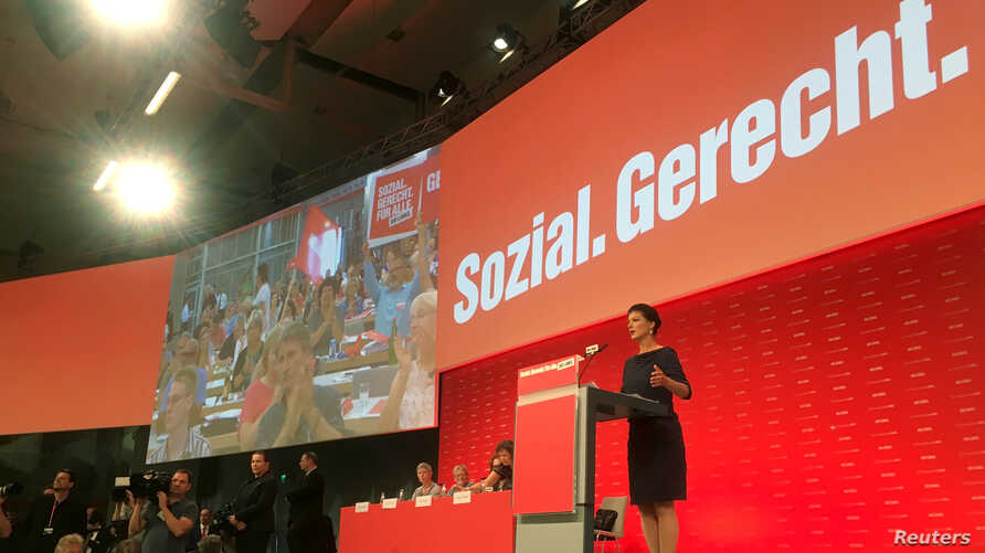 FILE - Top candidate of Germany's left-wing party Die Linke Sahra Wagenknecht delivers a speech during a party congress in Hanover, Germany, June 11, 2017.