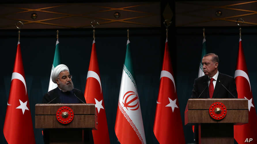 FILE - Iran's President Hassan Rouhani, left, and his Turkish counterpart Recep Tayyip Erdogan speak during a joint news conference in Ankara, Turkey, April 16, 2016.