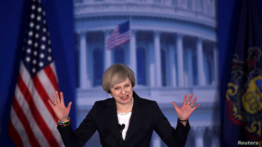 """Britain's Prime Minister Theresa May arrives to speak during the 2017 """"Congress of Tomorrow"""" Joint Republican Issues Conference in Philadelphia, Pennsylvania, Jan. 26, 2017."""