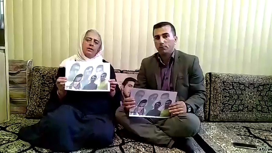 Ameneh Ghaderi, mother of detained Iranian Kurdish activist Zaniar Moradi, Amjad Hossein Panahi, brother of another detained Iranian Kurdish activist, Ramin Hossein Panahi, make a statement from Marivan, Iran, on September 7, 2018.