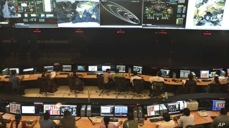 FILE - Indian Space Research Organization (ISRO) scientist and engineers monitor the movements of India's Mars orbiter at their Spacecraft Control Center in Bangalore, India.