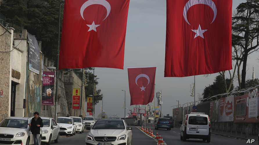 A main street decorated with Turkish flags near the Reina club four days after the New Year's day attack, in Istanbul, Wednesday, Jan. 4, 2017.