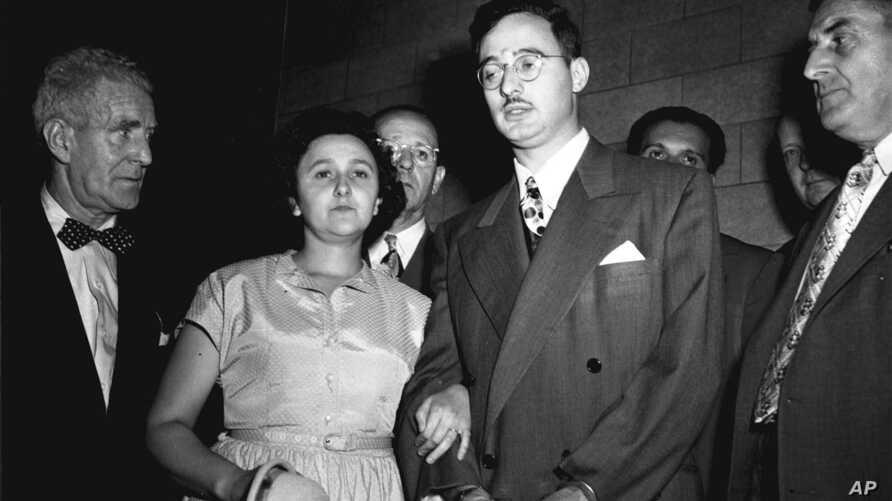 In this 1951 file photo, Ethel and Julius Rosenberg, center, are shown during their trial for espionage in New York.