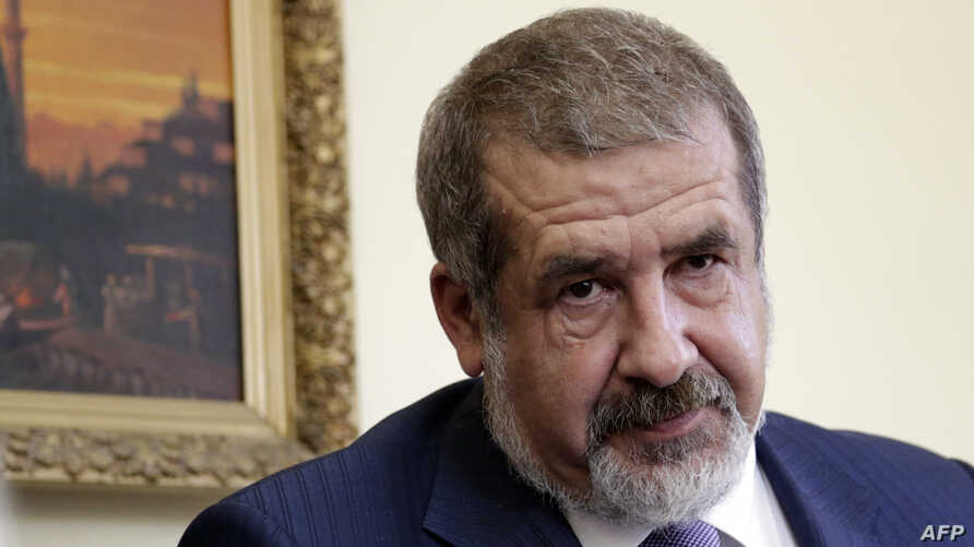 FILE - The leader of the Crimean Tatars' assembly, known as the Mejlis, Refat Chubarov, attends a press conference in the Crimean capital, Simferopol, on May 16 2014.