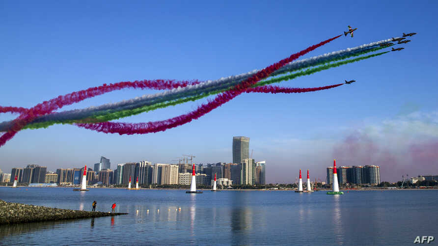 The United Arab Emirates' Al-Fursan (The Knights) National Aerobatic Team performs with smoke with the colours of the UAE flag, during the 2018 Red Bull Air Race World Championship in the Emirati capital Abu Dhabi on February 3, 2018.