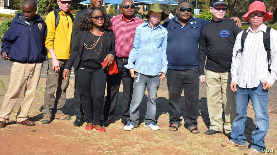 People with albinism pose with campaigners for their rights in the capital of Lilongwe, Malawi, in early 2016 before the start of street protests against recent attacks. Albinos are targeted because of the false belief that their body parts have powe