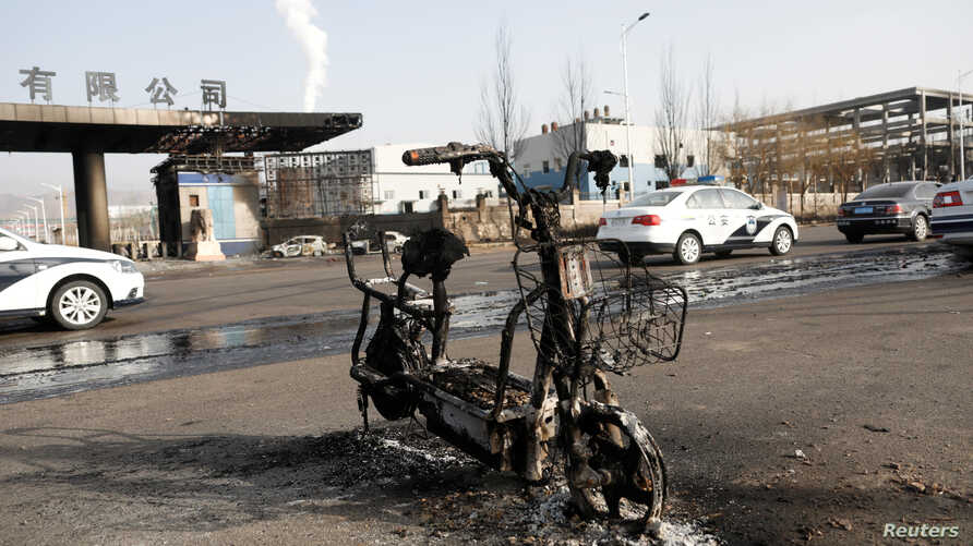 A burnt electric bicycle is pictured following a blast near a chemical plant in Zhangjiakou, Hebei province, China, Nov. 28, 2018.
