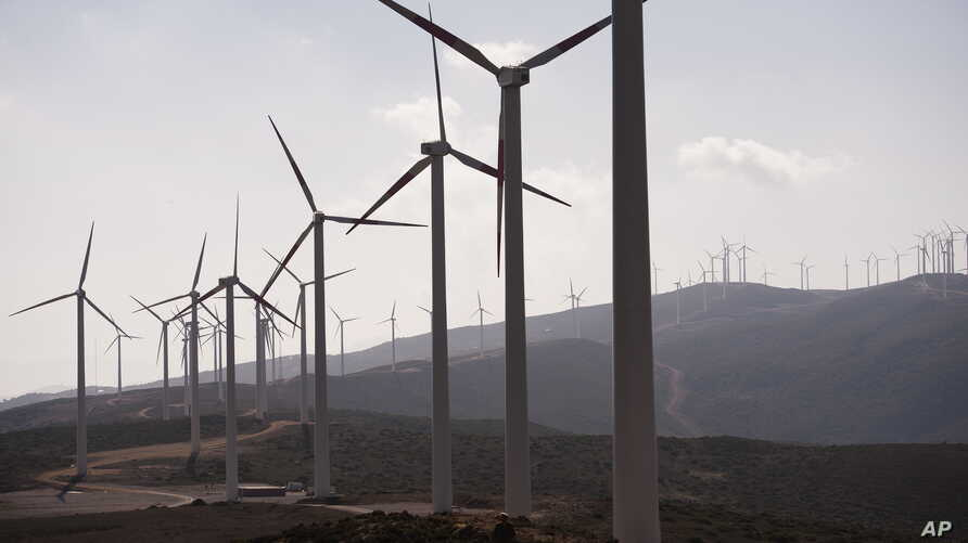 Wind farms like this array of turbines near Tangiers, Morocco, present a renewable energy alternative to traditional sources of electricity in Africa.