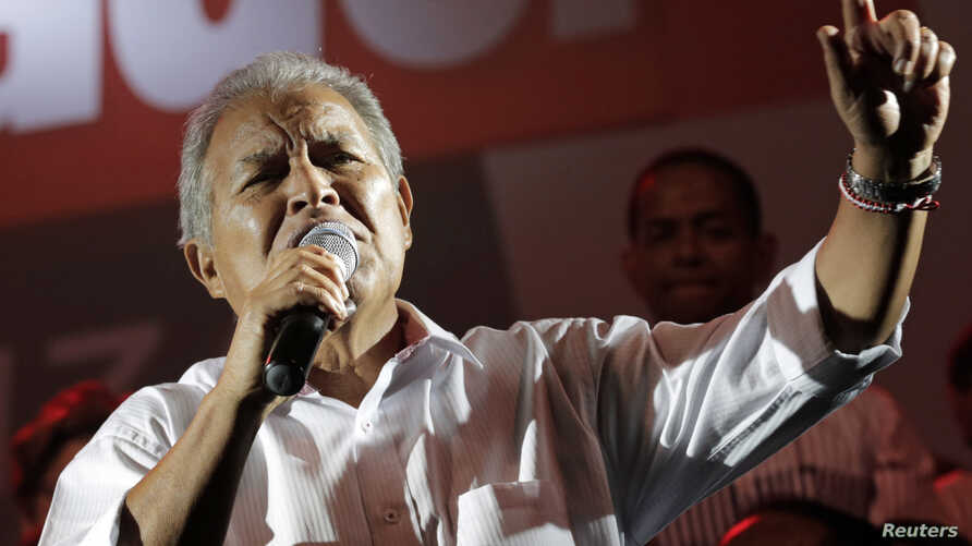 FILE - Salvador Sanchez Ceren, the presidential candidate for the Farabundo Marti National Liberation Front (FMLN), gives a speech to his supporters, after the official election results were released, in San Salvador, March 9, 2014.