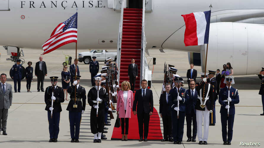 French President Emmanuel Macron and his wife Brigitte Macron arrive for their state visit to Washington and meetings with U.S. President Donald Trump after landing at Joint Base Andrews in Maryland, April 23, 2018.