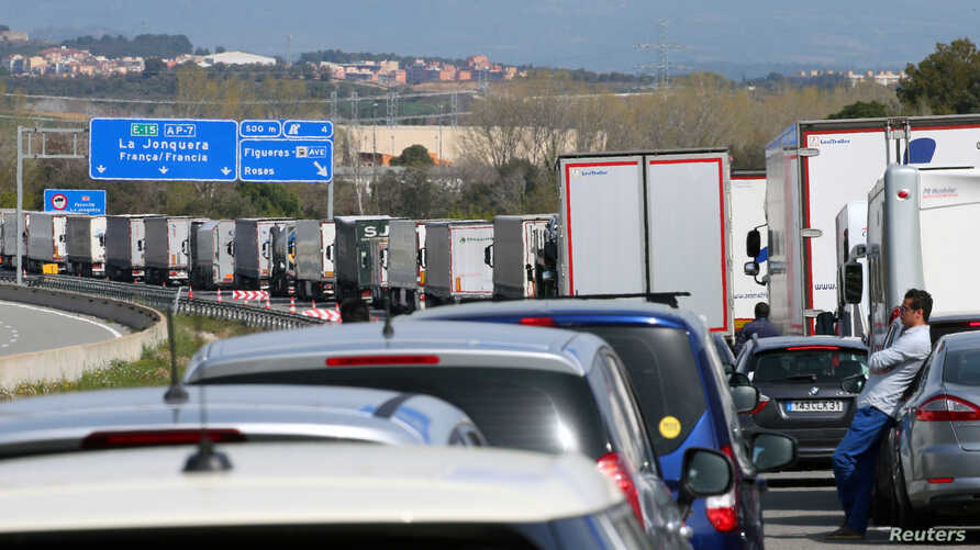 Vehicles on the AP-7 highway are stuck in traffic due to a protest organized by pro-independence supporters, near Figueres, Spain, March 27, 2018.