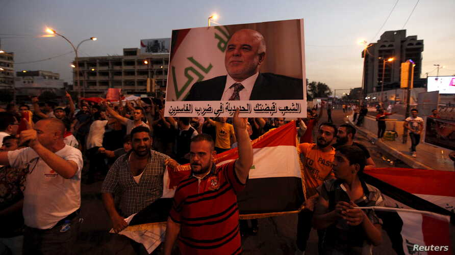 People shout slogans during a demonstration to show support for Iraqi Prime Minister Haider al-Abadi at Tahrir Square in central Baghdad, Aug., 9, 2015.