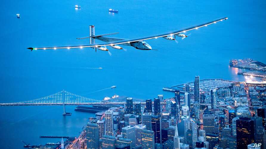 FILE - Solar Impulse 2 flies over San Francisco, April 23, 2016. The solar-powered airplane has left Pennsylvania for New York City on the latest leg of its globe-circling voyage.
