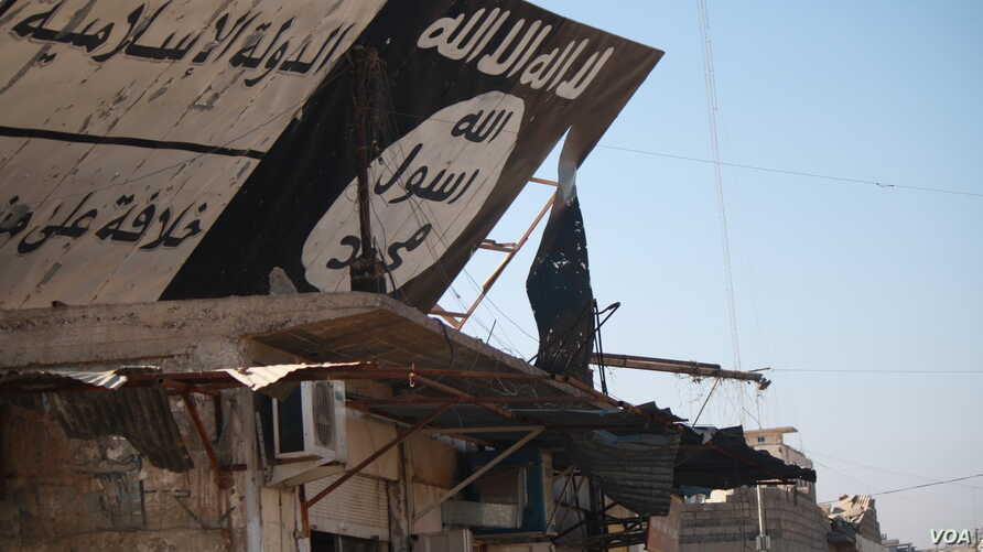 After 100 days of fighting, Iraqi forces took all of eastern Mosul back from IS militants and are now planning to begin fighting in the western part of the city in the coming days.  This IS sign, like many, was destroyed when Iraqi forces took over,