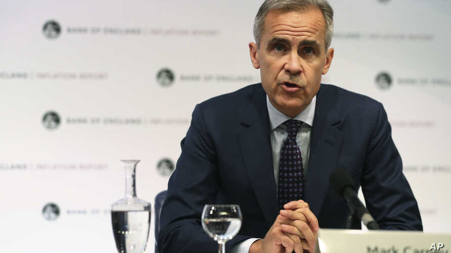 Bank of England Governor, Mark Carney, speaks during a media conference to present the central bank's quarterly Inflation Report, in London, Aug. 2, 2018.
