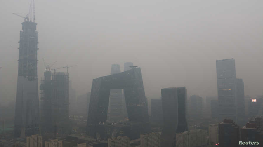 FILE - Beijing's landmark buildings are seen during a polluted day in Beijing, China, Nov. 18, 2016.