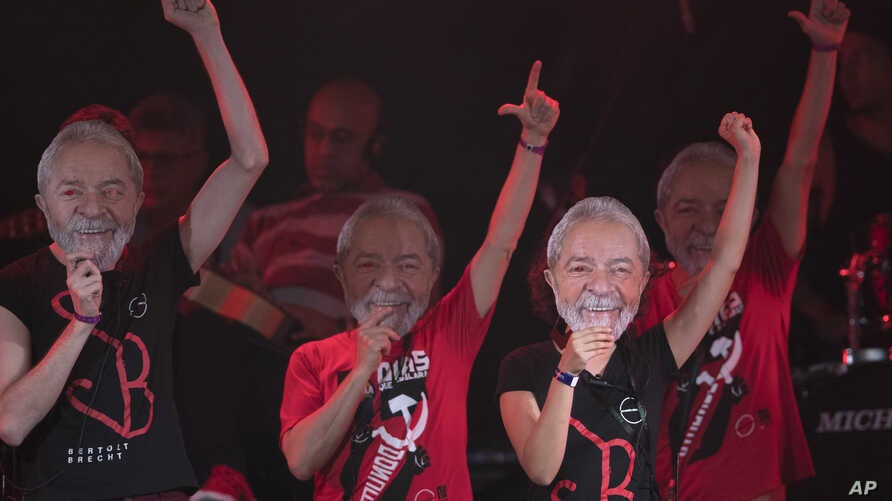 Artists wearing masks depicting former Brazilian President Luiz Inacio da Silva perform at the Lula Free festival in Rio de Janeiro, Brazil, July 28, 2018. The Workers' Party named the jailed former president as its nominee for president in October'