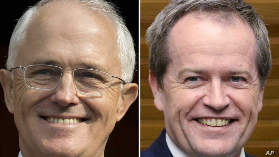 FILE - This combination of file photos from April 15, 2016, and July 8, 2014, shows Australian Prime Minister Malcolm Turnbull, left, and Australian opposition leader Bill Shorten.