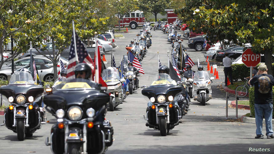 FILE - Patriot Guard Riders escort a motorcade carrying 200 POWs for the 40th anniversary of the homecoming of Vietnam POWs at Richard Nixon Presidential Library and Museum in Yorba Linda, California, May 23, 2013.