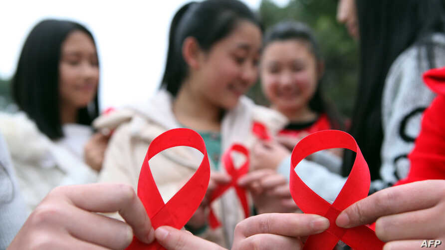 Volunteers take part in an event to mark World Aids Day in Chongqing, China, Nov. 30, 2015.