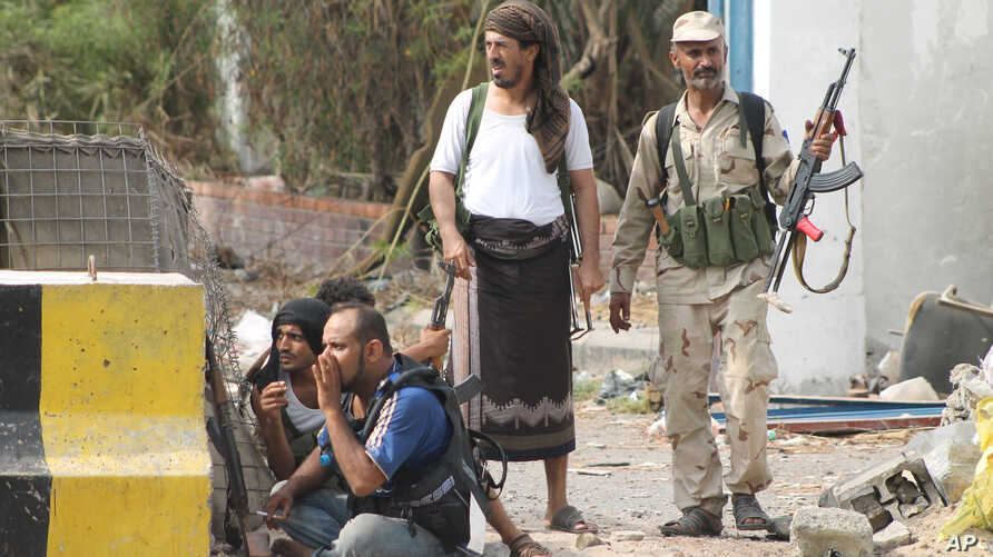 Pro-Yemen government fighters are at the frontline against Shi'ite Houthi rebels in the port city of Aden, Yemen, July 16, 2015.
