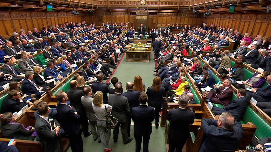 Britain's Prime Minister Theresa May addresses the House of Commons on her government's reaction to the poisoning of former Russian intelligence officer Sergei Skripal and his daughter Yulia in Salisbury, in London, March 14, 2018.