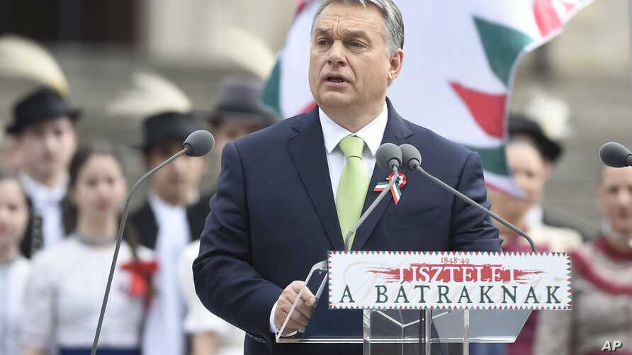 Hungarian Prime Minister Viktor Orban delivers his speech during a ceremony celebrating the national holiday, the 169th anniversary of the outbreak of the 1848 revolution and war of independence against the Habsburg rule at the Hungarian National Mus