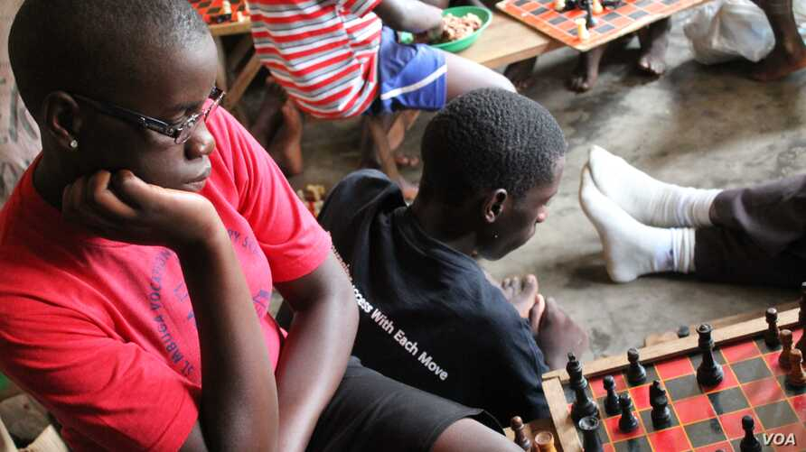 Phiona Mutesi considers a move at the Sports Outreach ministry in Kampala, Uganda, January 28, 2012. (H. Heuler/VOA)