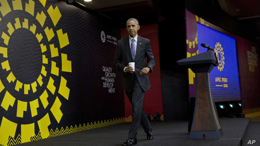 President Barack Obama walks away from the podium after finishing his news conference at the Asia-Pacific Economic Cooperation (APEC) in Lima, Peru, Nov. 20, 2016.