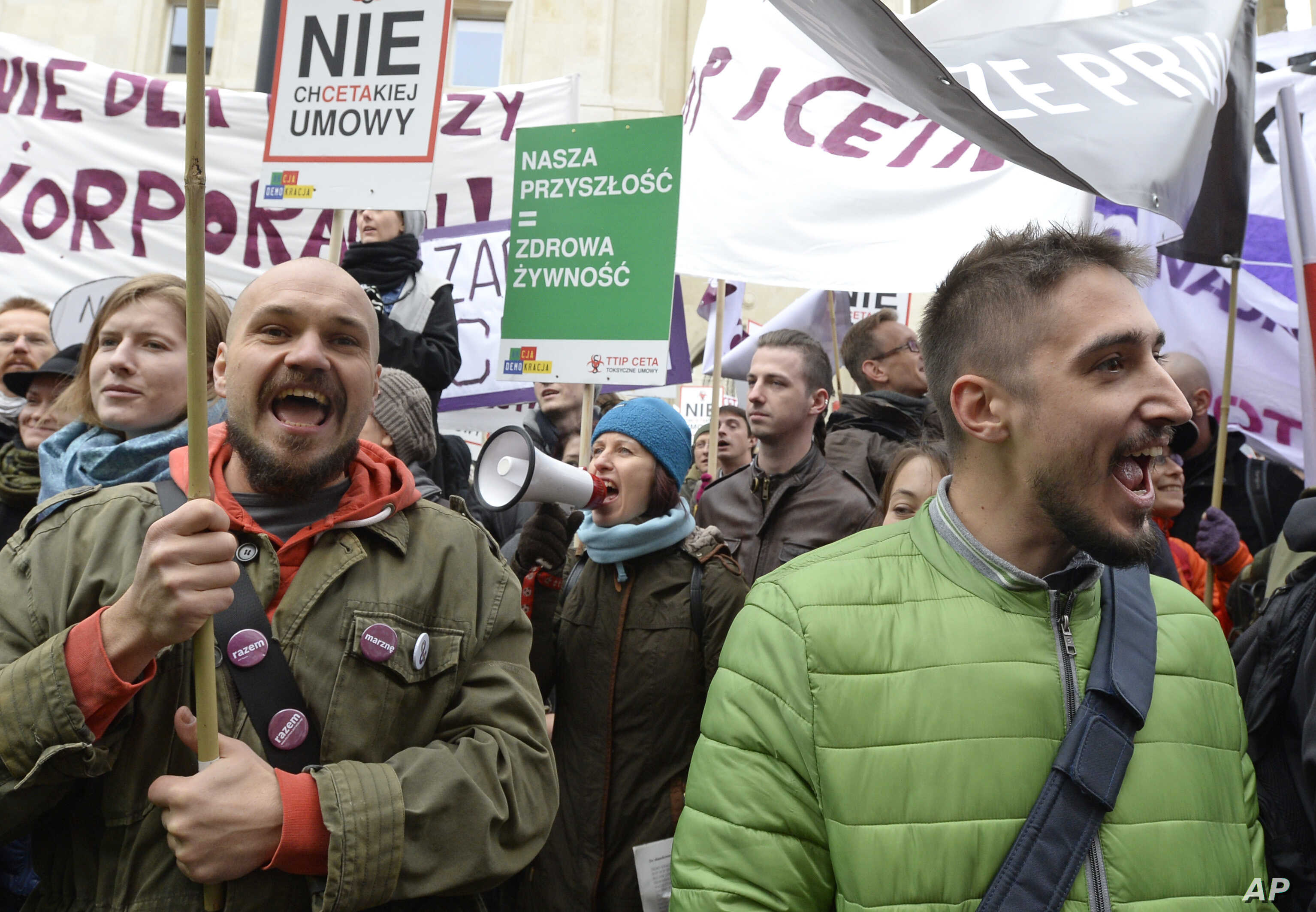 CETA Trade Deals: Protesters shout slogans during a march against trade deals with Canada and the U.S. in Warsaw, Poland, Saturday, Oct. 15, 2016.