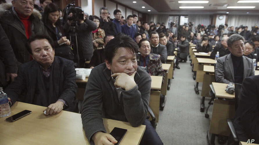 South Korean owners who run factories in the suspended inter-Korean Kaesong Industrial Complex, attend an emergency meeting held by the council of South Korean companies operating in the industrial park, in Seoul, South Korea, Friday, Feb. 12, 2016.