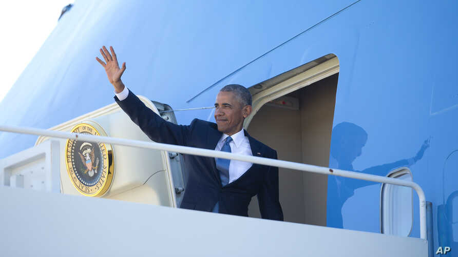 President Barack Obama waves as he boards Air Force One, June 29, 2016, at Andrews Air Force Base, Md.