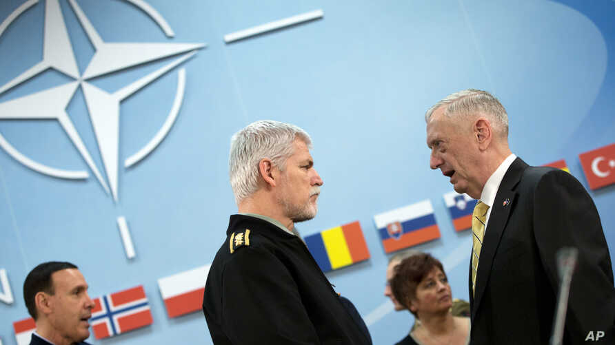Chairman of the Military Committee, Gen. Petr Pavel, center, speaks with U.S. Secretary of Defense Jim Mattis, right, during a meeting at NATO headquarters in Brussels, Feb. 16, 2017.