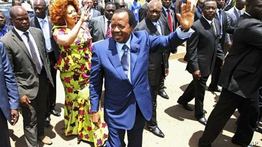 Cameroon's President Paul Biya waves outside a polling center after casting his vote in the capital Yaounde, October 9, 2011.
