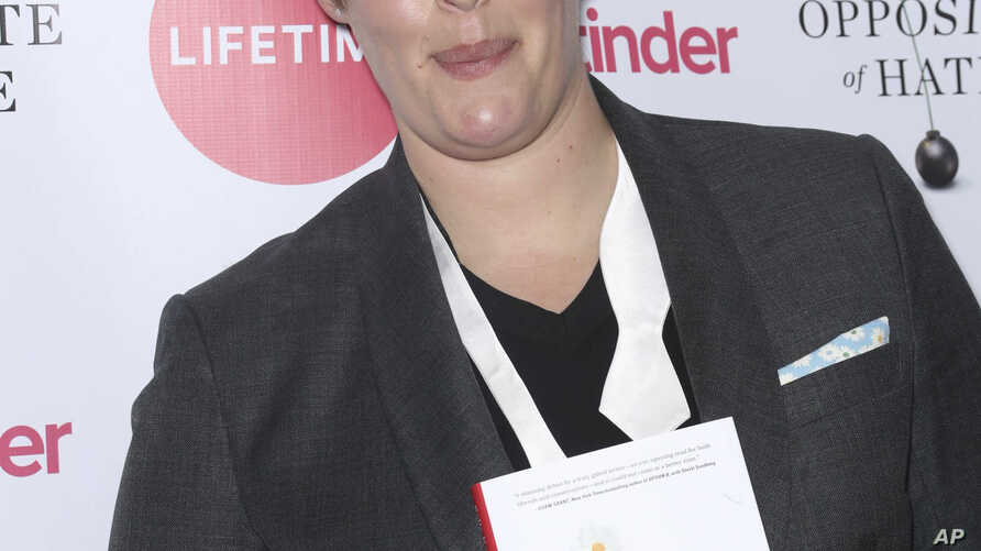 """FILE - Sally Kohn appears at a launch event for her book, """"The Opposite of Hate,""""  in New York, April 6, 2018."""